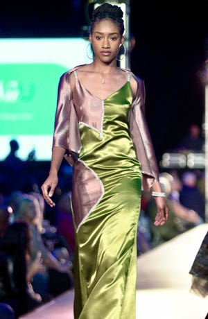 Models show off the latest fashion trends at the 12th annual Rochester Fashion Week's Light up the Night Finale Runway Show.