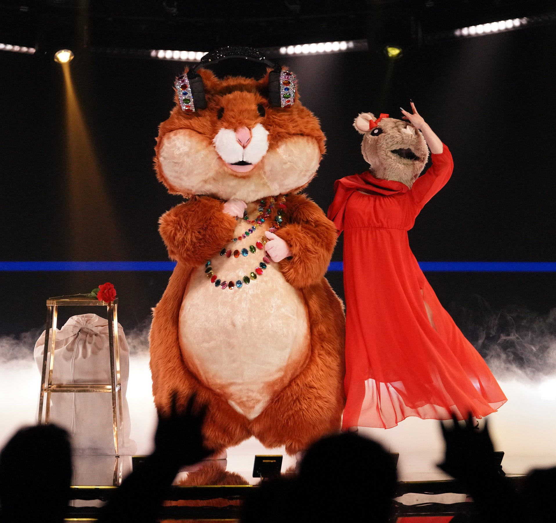 The Masked Singer : Hamster runs off his wheel. Wildcard Jester makes eerie costume debut