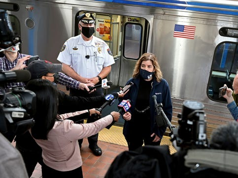 SEPTA General Manager Leslie Richards speaks during a news conference as SEPTA Transit Police Chief Thomas Nestel III stands behind her on an El platform at the 69th Street Transportation Center, Monday, Oct. 18, 2021, in Philadelphia, following a brutal rape on the El, as other riders watched, over the weekend.