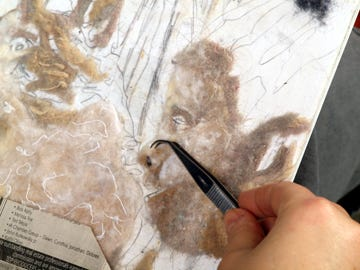 A close-up look at how Pocono artist Heidi Hooper places lint on canvas to create unique portraits.