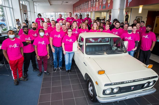 Employees at Toyota of Muncie wear pink for breast cancer awareness.
