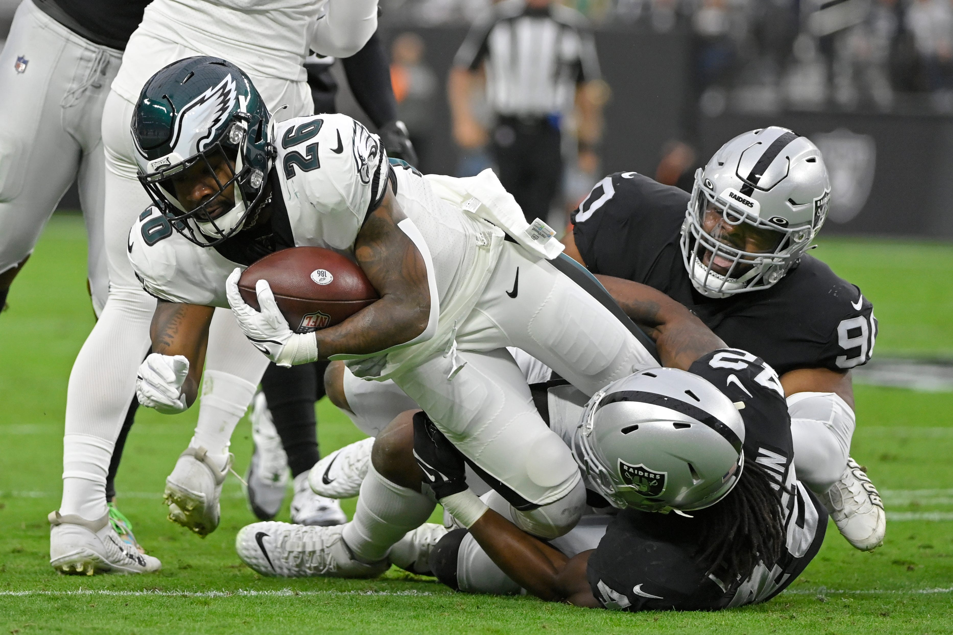 Miles Sanders carted off with ankle injury after strong start as Eagles suffer ugly loss to Raiders