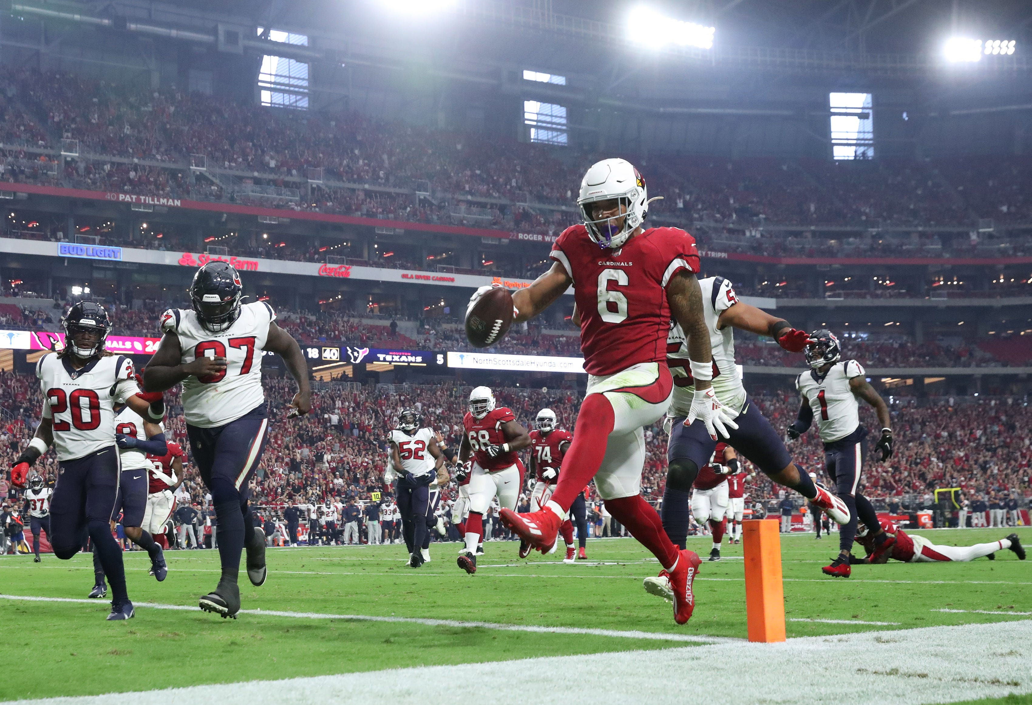 Cardinals stick to their familiar script in improving to 7-0 in rout of Texans