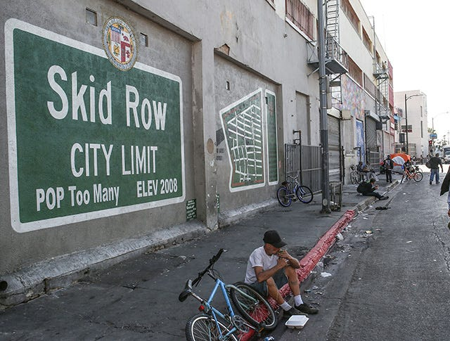 Many inmates released under Prop 47 have ended up homeless on the streets of Los Angeles' infamous Skid Row, shown here in November. Jay Calderon/The Desert Sun