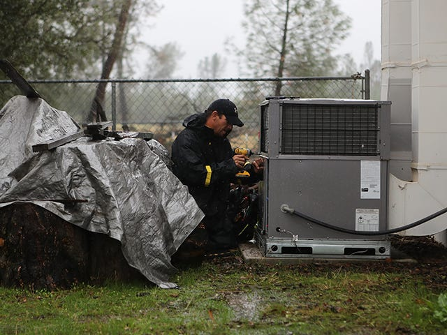 Former meth addict Tim Wilson works on an air conditioning unit in Redding, Calif. He reduced multiple convictions under Prop 47. Andreas Fuhrmann/The Record Searchlight