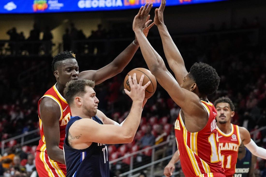 Hawks muscle up on Mavericks in season opener for both