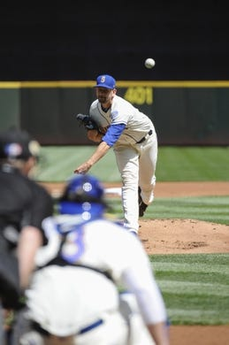 Jul 30, 2017; Seattle, WA, USA; Seattle Mariners starting pitcher James Paxton (65) pitches to the New York Mets during the first inning at Safeco Field. Mandatory Credit: Steven Bisig-USA TODAY Sports