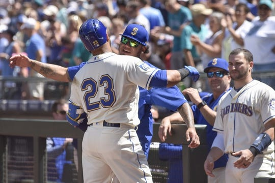Jul 30, 2017; Seattle, WA, USA; Seattle Mariners designated hitter Nelson Cruz (23) and Seattle Mariners pitcher Felix Hernandez (34) celebrate after Cruz hit a 3-run home run against the New York Mets during the first inning at Safeco Field. Mandatory Credit: Steven Bisig-USA TODAY Sports