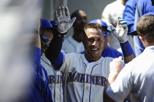 Jul 30, 2017; Seattle, WA, USA; Seattle Mariners right fielder Leonys Martin (12) celebrates after hitting a solo home run against the New York Mets during the second inning at Safeco Field. Mandatory Credit: Steven Bisig-USA TODAY Sports