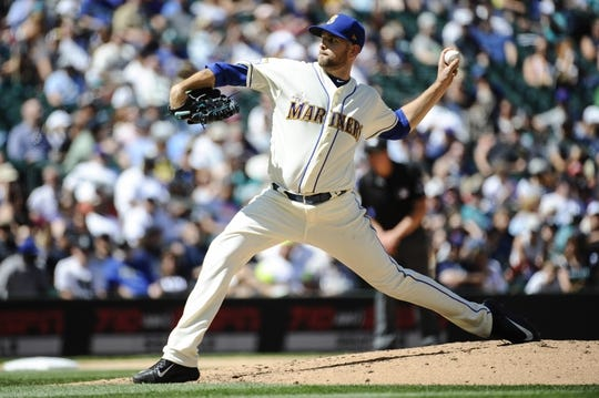 Jul 30, 2017; Seattle, WA, USA; Seattle Mariners starting pitcher James Paxton (65) pitches to the New York Mets during the sixth inning at Safeco Field. Mandatory Credit: Steven Bisig-USA TODAY Sports