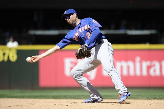 Jul 30, 2017; Seattle, WA, USA; New York Mets second baseman Neil Walker (20) throws the ball to first base during the sixth inning against the Seattle Mariners at Safeco Field. Mandatory Credit: Steven Bisig-USA TODAY Sports