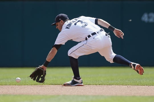 Aug 24, 2017; Detroit, MI, USA; Detroit Tigers second baseman Ian Kinsler (3) makes a play on a ball hit by New York Yankees left fielder Brett Gardner (not pictured) in the first inning at Comerica Park. Mandatory Credit: Rick Osentoski-USA TODAY Sports