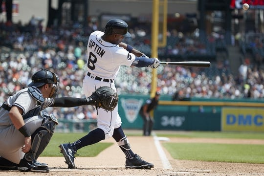 Aug 24, 2017; Detroit, MI, USA; Detroit Tigers left fielder Justin Upton (8) hits a home run in the first inning against the New York Yankees at Comerica Park. Mandatory Credit: Rick Osentoski-USA TODAY Sports