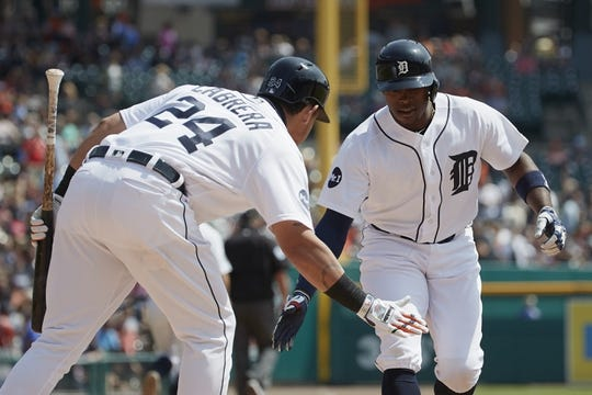 Aug 24, 2017; Detroit, MI, USA; Detroit Tigers left fielder Justin Upton (8) receives congratulations from designated hitter Miguel Cabrera (24) after he hit a home run in the first inning against the New York Yankees at Comerica Park. Mandatory Credit: Rick Osentoski-USA TODAY Sports