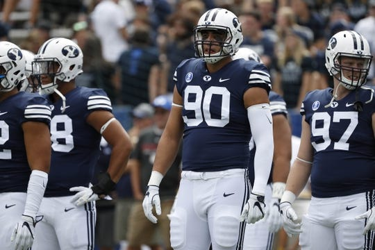 Aug 26, 2017; Provo, UT, USA; Brigham Young Cougars defensive lineman Corbin Kaufusi (90) waits to take the field prior to their game against the Portland State Vikings at LaVell Edwards Stadium. Mandatory Credit: Jeff Swinger-USA TODAY Sports
