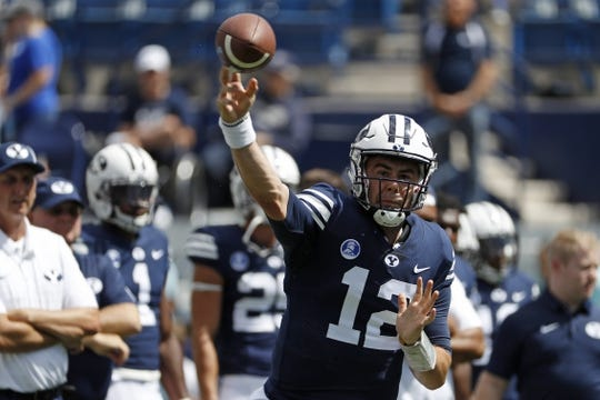 Aug 26, 2017; Provo, UT, USA; Brigham Young Cougars quarterback Tanner Mangum (12) warms up prior to their game against the Portland State Vikings at LaVell Edwards Stadium. Mandatory Credit: Jeff Swinger-USA TODAY Sports