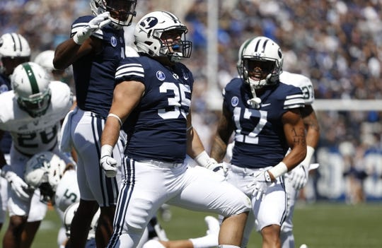 Aug 26, 2017; Provo, UT, USA; Brigham Young Cougars linebacker Va'a Niumatalolo (35) reacts after a tackle on Portland State Vikings wide receiver Kahlil Dawson (5) on the opening kickoff at LaVell Edwards Stadium. Mandatory Credit: Jeff Swinger-USA TODAY Sports