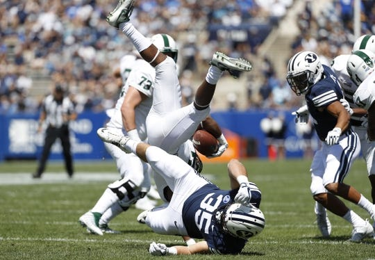 Aug 26, 2017; Provo, UT, USA; Brigham Young Cougars linebacker Va'a Niumatalolo (35) makes the tackle on Portland State Vikings wide receiver Kahlil Dawson (5) on the opening kickoff at LaVell Edwards Stadium. Mandatory Credit: Jeff Swinger-USA TODAY Sports