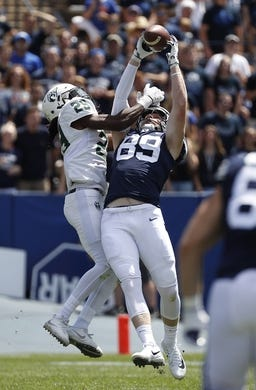 Aug 26, 2017; Provo, UT, USA; Brigham Young Cougars tight end Matt Bushman (89) makes a reception against Portland State Vikings cornerback Donovan Olumba (29) in the first quarter at LaVell Edwards Stadium. Mandatory Credit: Jeff Swinger-USA TODAY Sports