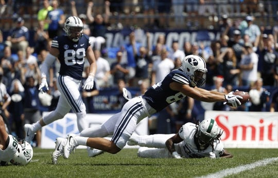 Aug 26, 2017; Provo, UT, USA; Brigham Young Cougars wide receiver Neil Pau'u (84) dives for a touchdown past Portland State Vikings linebacker Sam Bodine (36) in the first quarter at LaVell Edwards Stadium. Mandatory Credit: Jeff Swinger-USA TODAY Sports