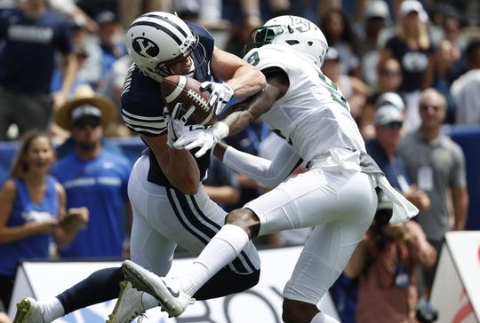 Aug 26, 2017; Provo, UT, USA; Brigham Young Cougars wide receiver Talon Shumway (21) makes a reception against Portland State Vikings cornerback Chris Seisay (9) for a first down in the second quarter at LaVell Edwards Stadium. Mandatory Credit: Jeff Swinger-USA TODAY Sports
