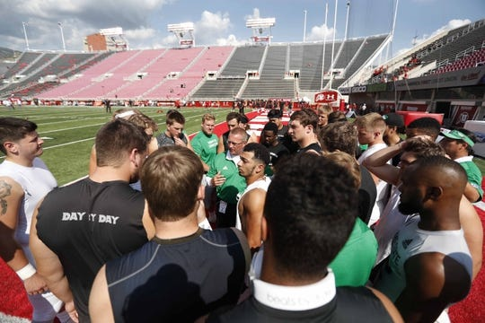 Aug 31, 2017; Salt Lake City, UT, USA; Players from North Dakota Fighting Hawks get together prior to their game against the Utah Utes at Rice-Eccles Stadium. Mandatory Credit: Jeff Swinger-USA TODAY Sports