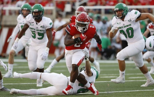 Aug 31, 2017; Salt Lake City, UT, USA; Utah Utes running back Zack Moss (2) runs the ball past North Dakota Fighting Hawks linebacker Jake Disterhaupt (48) in the first quarter at Rice-Eccles Stadium. Mandatory Credit: Jeff Swinger-USA TODAY Sports