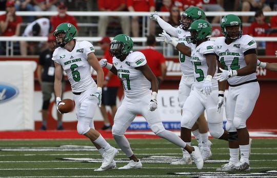 Aug 31, 2017; Salt Lake City, UT, USA; North Dakota Fighting Hawks defensive back Evan Holm (6) celebrates a first quarter interception against the Utah Utes at Rice-Eccles Stadium. Mandatory Credit: Jeff Swinger-USA TODAY Sports
