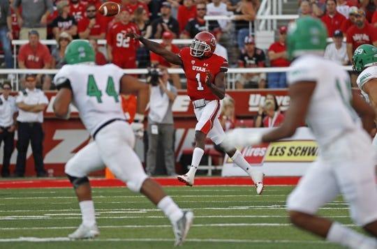 Aug 31, 2017; Salt Lake City, UT, USA; Utah Utes quarterback Tyler Huntley (1) passes the ball in the first quarter against the North Dakota Fighting Hawks at Rice-Eccles Stadium. Mandatory Credit: Jeff Swinger-USA TODAY Sports