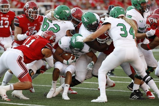 Aug 31, 2017; Salt Lake City, UT, USA; North Dakota Fighting Hawks defensive back Hayden Blubaugh (12) runs the ball in the first quarter against the Utah Utes at Rice-Eccles Stadium. Mandatory Credit: Jeff Swinger-USA TODAY Sports
