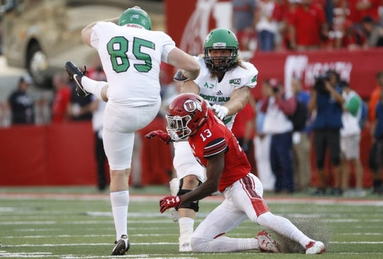 Aug 31, 2017; Salt Lake City, UT, USA; Utah Utes defensive back Marquise Blair (13) runs into North Dakota Fighting Hawks punter Austin Dussold (85) for a personal foul in the second quarter at Rice-Eccles Stadium. Mandatory Credit: Jeff Swinger-USA TODAY Sports