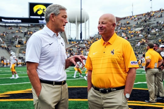 Sep 2, 2017; Iowa City, IA, USA; Iowa Hawkeyes head coach Kirk Ferentz and Wyoming Cowboys head coach Craig Bohl talk before the game at Kinnick Stadium. Mandatory Credit: Jeffrey Becker-USA TODAY Sports