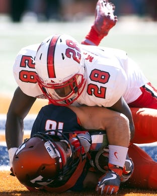 Sep 2, 2017; Champaign, IL, USA; Illinois Fighting Illini wide receiver Mike Dudek (18) scores a touchdown and is tackled by Ball State Cardinals safety Armani McNulty (28) during the 1st Quarter at Memorial Stadium. Mandatory Credit: Mike Granse-USA TODAY Sports