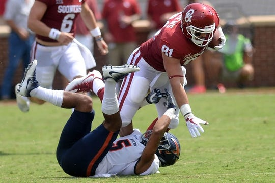 Sep 2, 2017; Norman, OK, USA; UTEP Miners defensive back Nik Needham (5) tackles Oklahoma Sooners tight end Mark Andrews (81) during the first quarter at Gaylord Family - Oklahoma Memorial Stadium. Mandatory Credit: Mark D. Smith-USA TODAY Sports
