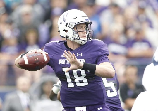 Sep 2, 2017; Evanston, IL, USA; Northwestern Wildcats quarterback Clayton Thorson (18) drops back to pass during the first quarter against the Nevada Wolf Pack at Ryan Field. Mandatory Credit: Caylor Arnold-USA TODAY Spor