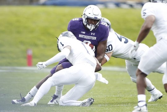 Sep 2, 2017; Evanston, IL, USA; Northwestern Wildcats tight end Garrett Dickerson (9) is tackled by Nevada Wolf Pack defensive back Vosean Crumbie (1) during the first quarter of the game at Ryan Field. Mandatory Credit: Caylor Arnold-USA TODAY Spor