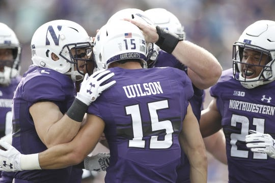 Sep 2, 2017; Evanston, IL, USA; Northwestern Wildcats wide receiver Macan Wilson (15) celebrates with his teammates after scoring a touchdown during the first quarter against the Nevada Wolf Pack at Ryan Field. Mandatory Credit: Caylor Arnold-USA TODAY Spor