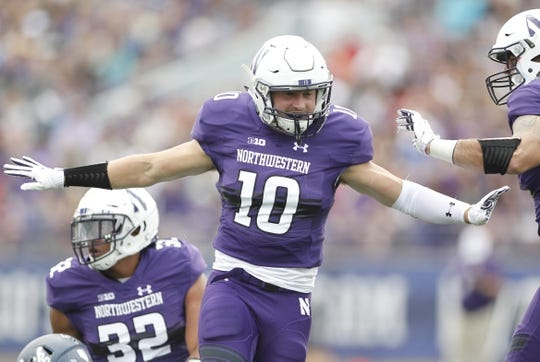 Sep 2, 2017; Evanston, IL, USA; Northwestern Wildcats linebacker Brett Walsh (10) celebrates after a tackle during the first quarter against the Nevada Wolf Pack at Ryan Field. Mandatory Credit: Caylor Arnold-USA TODAY Spor