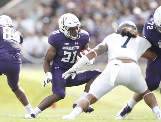 Sep 2, 2017; Evanston, IL, USA; Northwestern Wildcats running back Justin Jackson (21) runs the ball while Nevada Wolf Pack linebacker Gabriel Sewell (7) looks to tackled during the first quarter at Ryan Field. Mandatory Credit: Caylor Arnold-USA TODAY Spor