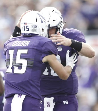Sep 2, 2017; Evanston, IL, USA; Northwestern Wildcats wide receiver Macan Wilson (15) celebrates with quarterback Clayton Thorson (18) after scoring a touchdown during the first quarter against the Nevada Wolf Pack at Ryan Field. Mandatory Credit: Caylor Arnold-USA TODAY Spor