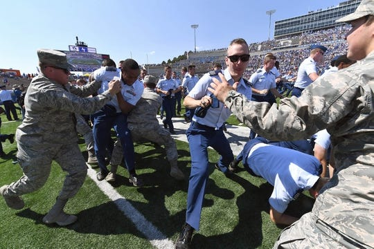 Sep 2, 2017; Colorado Springs, CO, USA; Air Force Falcons cadets rush off Falcon Field before the game against the Virginia Military Keydets at Falcon Stadium. Mandatory Credit: Ron Chenoy-USA TODAY Sports