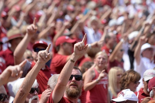 Sep 2, 2017; Norman, OK, USA; Oklahoma Sooners fans sing the fight song prior to action against the UTEP Miners at Gaylord Family - Oklahoma Memorial Stadium. Mandatory Credit: Mark D. Smith-USA TODAY Sports