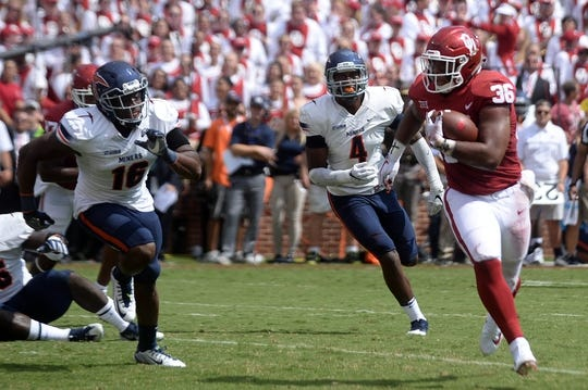 Sep 2, 2017; Norman, OK, USA; Oklahoma Sooners fullback Dimitri Flowers (36) eludes a tackle attempt by UTEP Miners linebacker Alvin Jones (16) during the first quarter at Gaylord Family - Oklahoma Memorial Stadium. Mandatory Credit: Mark D. Smith-USA TODAY Sports