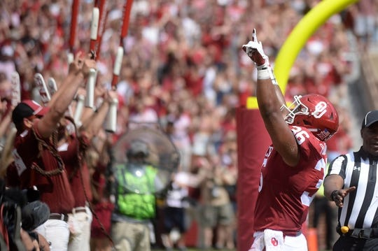 Sep 2, 2017; Norman, OK, USA; Oklahoma Sooners fullback Dimitri Flowers (36) reacts after scoring a touchdown against the UTEP Miners during the first quarter at Gaylord Family - Oklahoma Memorial Stadium. Mandatory Credit: Mark D. Smith-USA TODAY Sports