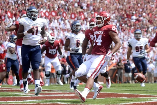 Sep 2, 2017; Norman, OK, USA; Oklahoma Sooners running back Rodney Anderson (24) scores a touchdown in front of UTEP Miners defensive lineman Denzel Chukwukelu (11) during the first quarter at Gaylord Family - Oklahoma Memorial Stadium. Mandatory Credit: Mark D. Smith-USA TODAY Sports