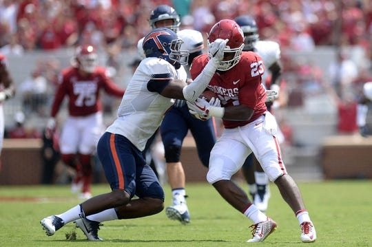 Sep 2, 2017; Norman, OK, USA; UTEP Miners linebacker Dylan Parsee (6) attempts to tackle Oklahoma Sooners running back Abdul Adams (23) during the first quarter at Gaylord Family - Oklahoma Memorial Stadium. Mandatory Credit: Mark D. Smith-USA TODAY Sports
