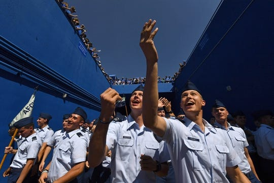 Sep 2, 2017; Colorado Springs, CO, USA; Air Force Falcons cadets reach for cash thrown from above the tunnel of Falcon Staduim before the game against the Virginia Military Keydets. Mandatory Credit: Ron Chenoy-USA TODAY Sports