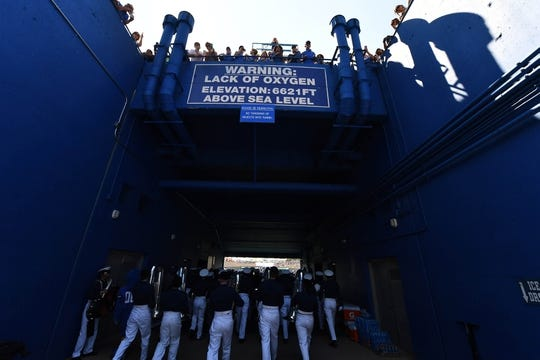 Sep 2, 2017; Colorado Springs, CO, USA; General oxygen warning sign above the Air Force Falcons band members before the game between the Virginia Military Keydets at Falcon Stadium. Mandatory Credit: Ron Chenoy-USA TODAY Sports