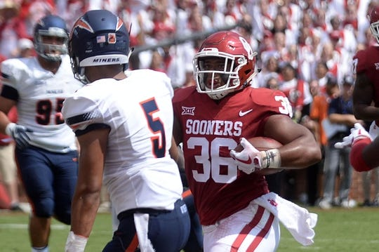 Sep 2, 2017; Norman, OK, USA; Oklahoma Sooners fullback Dimitri Flowers (36) scores a touchdown in front of UTEP Miners defensive back Nik Needham (5) during the first quarter at Gaylord Family - Oklahoma Memorial Stadium. Mandatory Credit: Mark D. Smith-USA TODAY Sports