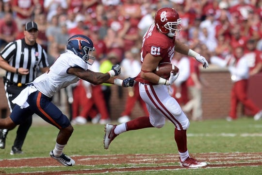 Sep 2, 2017; Norman, OK, USA; Oklahoma Sooners tight end Mark Andrews (81) eludes a tackle attempt by UTEP Miners defensive back Michael Lewis (2) during the second quarter at Gaylord Family - Oklahoma Memorial Stadium. Mandatory Credit: Mark D. Smith-USA TODAY Sports